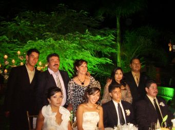 La Quinceañera with her parents, grandparents and boy friend's parents