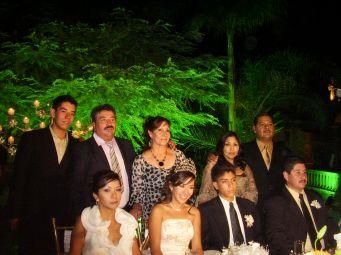 La Quinceañera with her parents, grandparents and boy friend's parents